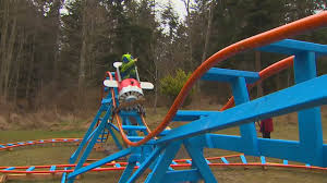 how cool is this navy pilot builds roller coaster in backyard for