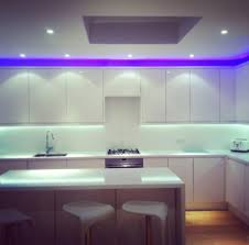 cool kitchen with blue led lights decor on backsplash and above
