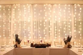 floor to ceiling backdrop with lights weddings