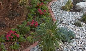 Home Landscaping Ideas by Bark Mulch Vs Rock Mulch Which Is Better Gt Landscapes