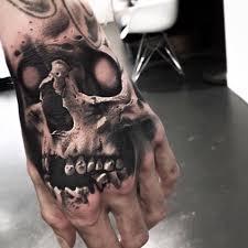 hand on shoulder tattoo dangerous skull tattoo on hand