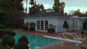 day sunset raked right small white backyard guest house pool house