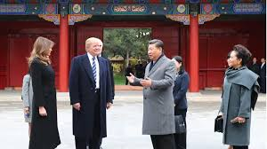 donald trump gets red carpet welcome in beijing but tough tests