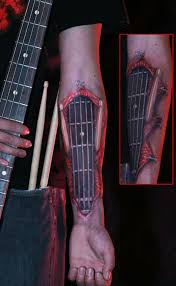 tattoo 3d guitar tattoo by rich ives guitar neck on arm it s a man s world