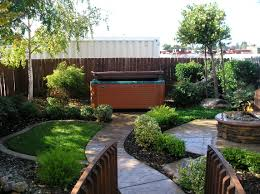 Fire Pit Backyard Designs by Exterior Design Elegant Bullfrog Spas With Waterfall And Fire Pit