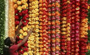 hindu garland a vendor arranges artificial garlands for sale at his stall ahead