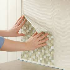 how to install a glass tile backsplash in the kitchen install tile backsplash press glass tile into the kitchen wall