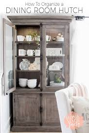 how to arrange dishes in china cabinet how to organize a dining room hutch more of our keswick