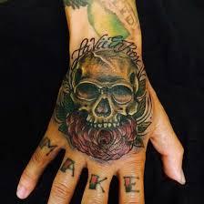 31 supreme skull tattoos gun