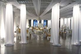 wedding backdrop ideas with columns draping can transform any boring or room into something