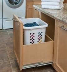 Bathroom Cabinet With Built In Laundry Hamper Roll Out Laundry Hamper Under The Bathroom Sink 99