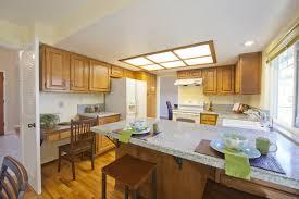 custom kitchen summer kitchens red tile wooden table summer