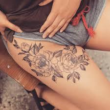 female thigh tattoos thigh tattoo i want the flowers for my 4 boys u0027 birthdays like