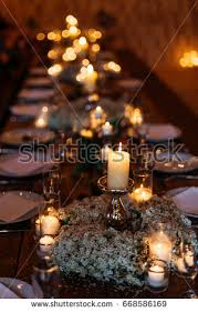 table decorations with candles and flowers festive wedding table setting forgetmenot flowers stock photo