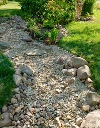 dry rock bed keep edges random use contrasting sized rocks