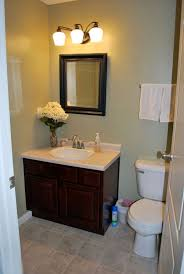 simple small bathroom ideas wooden vanity with simple black framed mirror for small bathroom