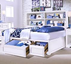classy dark blue paint bedroom design with white headboard and