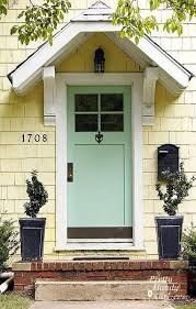 pale yellow house with light teal door front door color house