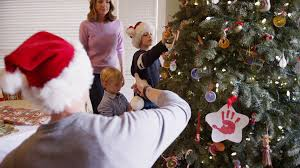 Decorated Christmas Tree Nz by Lovely White Family Decorating The Christmas Tree Together Stock