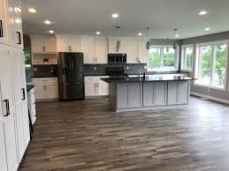white kitchen cabinets with vinyl plank flooring luxury vinyl plank flooring with white kitchen cabinets
