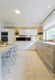 white kitchen cabinets with tile floor beige and white kitchen decor with tiled floor white cabinets