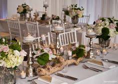 driftwood centerpieces driftwood centerpiece roots weddings