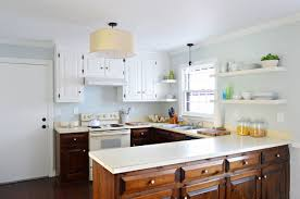 Painting Interior Of Kitchen Cabinets Painting Our Upper Cabinets White Young House Love