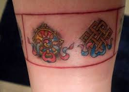 nice colored buddhist symbols tattoo on hand tattoo wf
