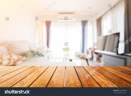 wooden board empty table front blurred stock photo 525454000
