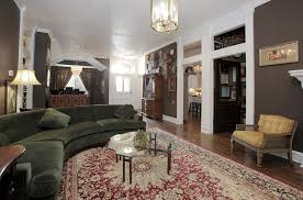 dallas sage green sofa living room eclectic with transom window
