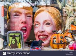 donald trump kw donald trump and hillary clinton masks in store window stock photo