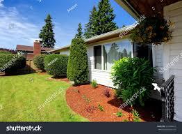 Beautiful Front Yard Landscaping - beautiful front yard landscape bright orange stock photo 220498663
