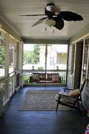 enclosed porch with painted board floors and ceilings porch