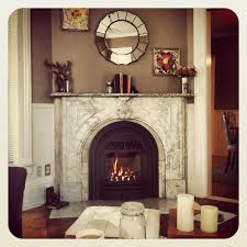 husband i refinished the fireplace this weekend love the valor windsor arch gas insert