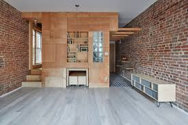 brick wall apartment manhattan apartment transforms into flexible live work space curbed