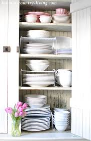 how do you arrange dishes in kitchen cabinets organizing kitchen cabinets in five easy steps town