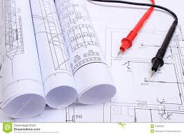 rolled electrical diagrams and cables of multimeter on drawing of