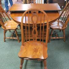 brothers oak dining table and 4 chairs