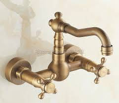 wall mount vessel sink faucets antique brass wall mounted kitchen faucet dual cross handles