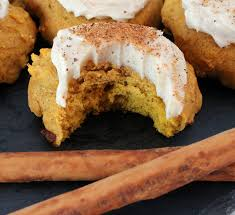 pumpkin spice cookies with cinnamon cheese frosting two