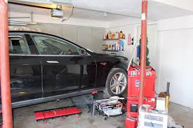 World Falcon Auto Salvage by Repairing A Salvage Tesla Model S Due To Flood Damage