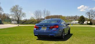 2016 subaru wrx sti review track test video performancedrive 2014 bmw m5 track tested at road america
