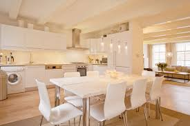family friendly accommodation the multatuli guest house travel kitchen with dining table and view to living