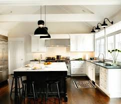 white kitchen with black island 129 best kitchen images on home kitchen ideas and