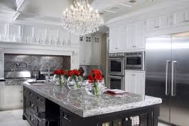 white cabinets with white granite dark granite countertops hgtv inside white kitchen with black