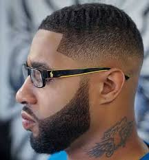 oval face with tapered afro haircut 50 fade and tapered haircuts for black men