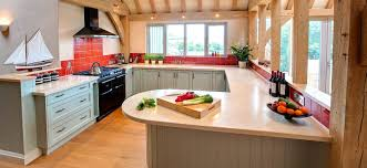 kitchen snack bar ideas green painted cupboards with curved corian breakfast bar kitchen