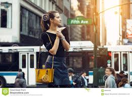 New York Travelers Stock images Beautiful tourist girl traveling and enjoying busy city life of jpg