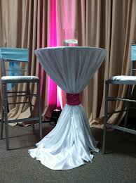 chair ties are one way to cinch a linen on a cocktail table chair