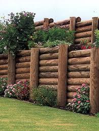 vertical logs as retaining wall garden pinterest logs walls